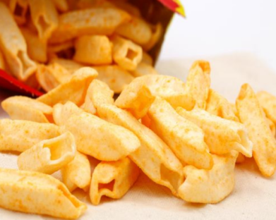 Puffed food produced by extrusion curing equipment
